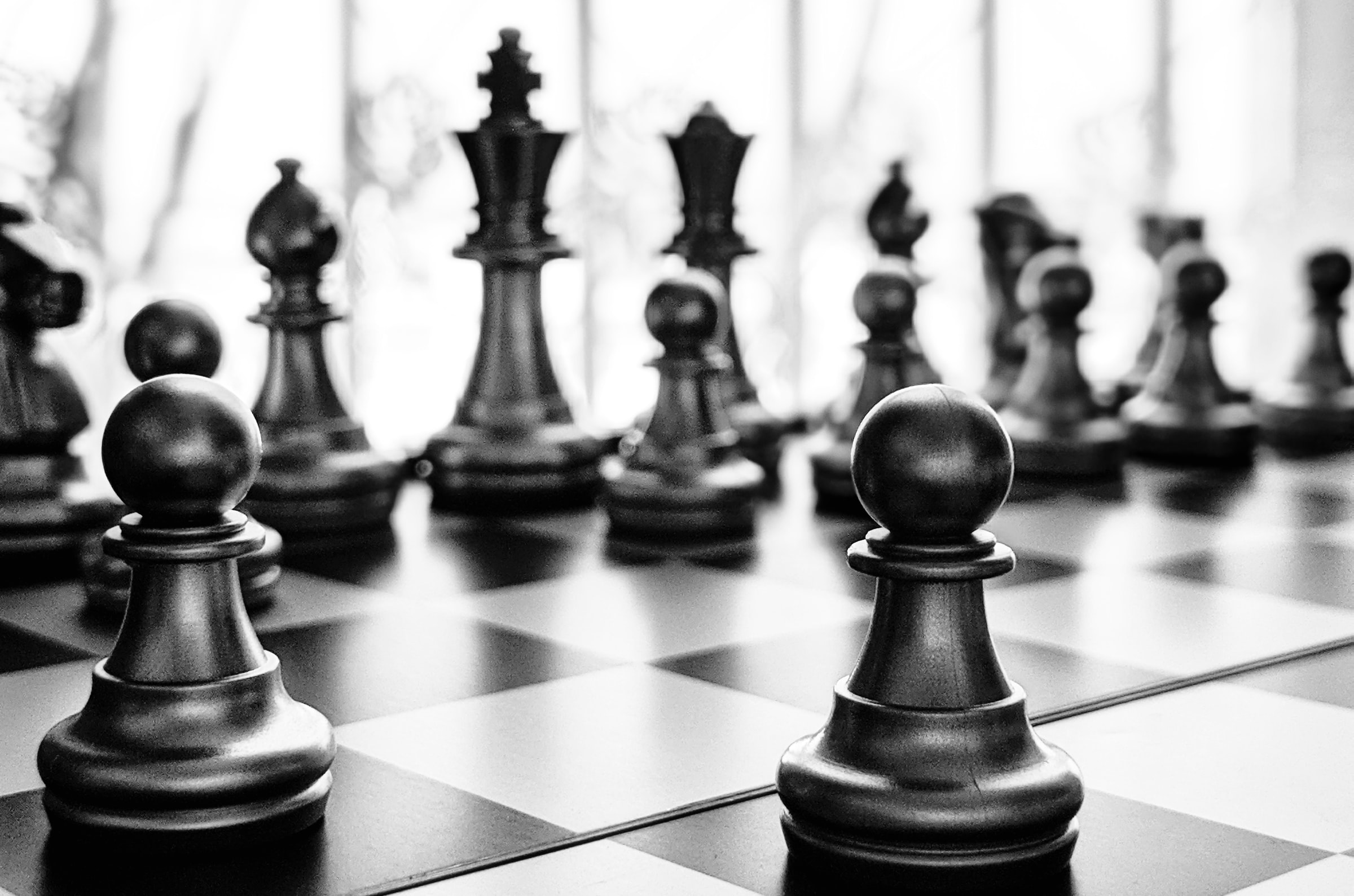 Black and white image of a chess game.