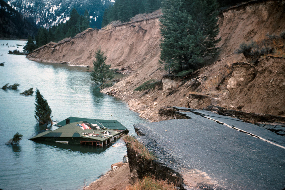 Taken shortly after the earthquake, this photo shows damage to a house and interstate due to the landslide.